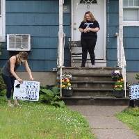 Hen Hud's Academy Staff Delivery Lawn Signs to Celebrate Seniors